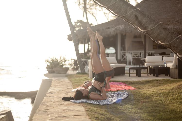 Rita Arnaus and Sierra Campbell doing Yoga at Cabarete Beach