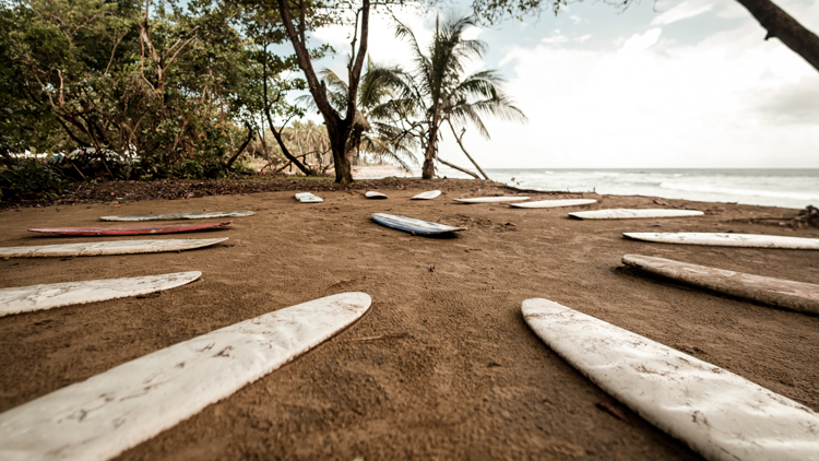 Surf boards lined up at Playa Encuentro